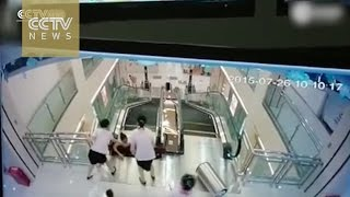Watch:Escalator accident kills a woman who lifts out her child at the last moment