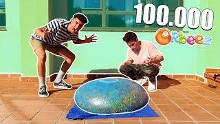 LLENAMOS una WUBBLE BUBBLE con 100.000 ORBEEZ!! (LA TIRAMOS DESDE 20 METROS!!) [Logan G]