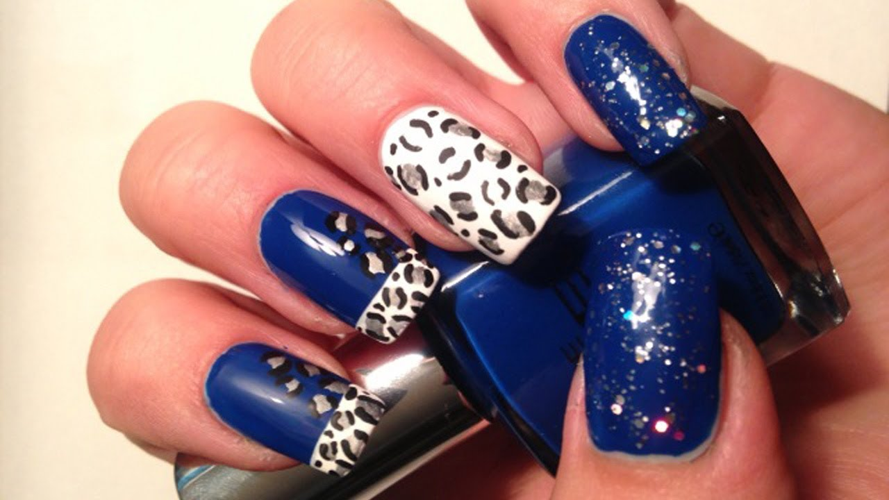 sparkly midnight blue leopard nail