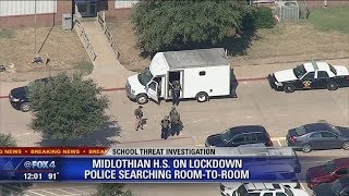 Police searching Midlothian High School room to room