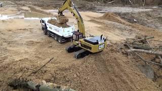 MAN TGA 8x8 dump truck & Caterpillar 345D LME excavator part 4