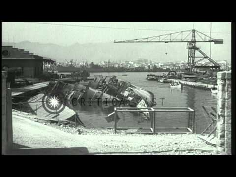 Wrecked ships and buildings after Allied bombings at Palerno harbor in Sicily, It...HD Stock Footage