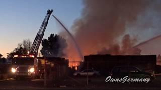 Two Ladder Fire Trucks Fighting Large Blaze in Pallet Yard