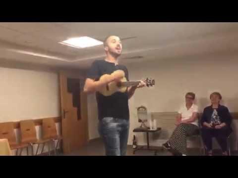 Joshua Aaron leading worship