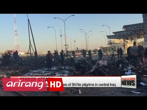 Suicide bombing kills at scores of Shi'ite pilgrims in central Iraq
