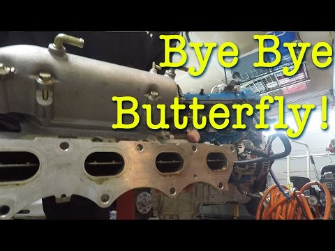 Removing the butterfly from the intake manifold on the Boosted Miata