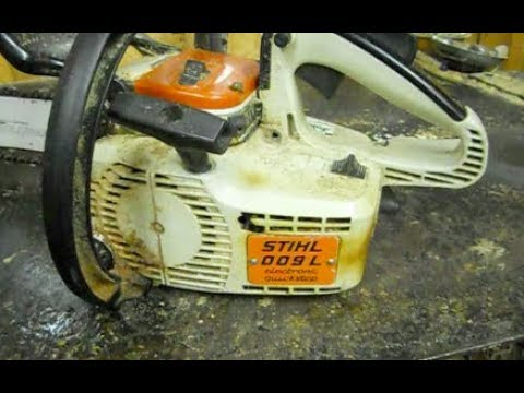 cleaning a chainsaw carburetor Stihl 009
