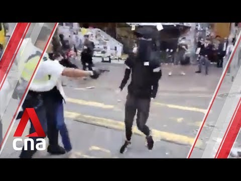 Hong Kong police officer shoots protester during morning clashes