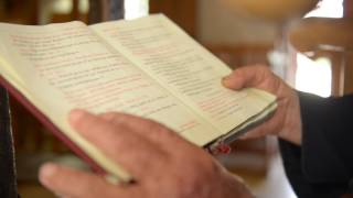 Priest in Church (holding a Bible) 01 / Free Stock Footage