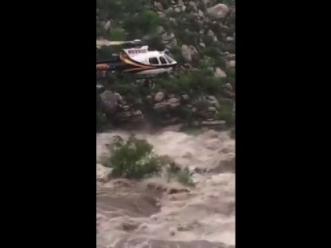 Associated Press: Raw: Chopper Lifts Flood Stranded Hikers To Safety
