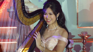 Kisses Delavin Playing Harp