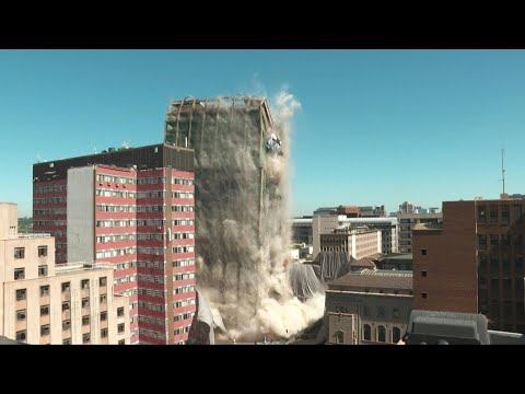 Johannesburg's Bank of Lisbon building demolished one year after deadly fire | AFP