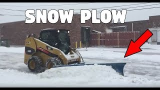Cat 246C Skid Steer Plowing