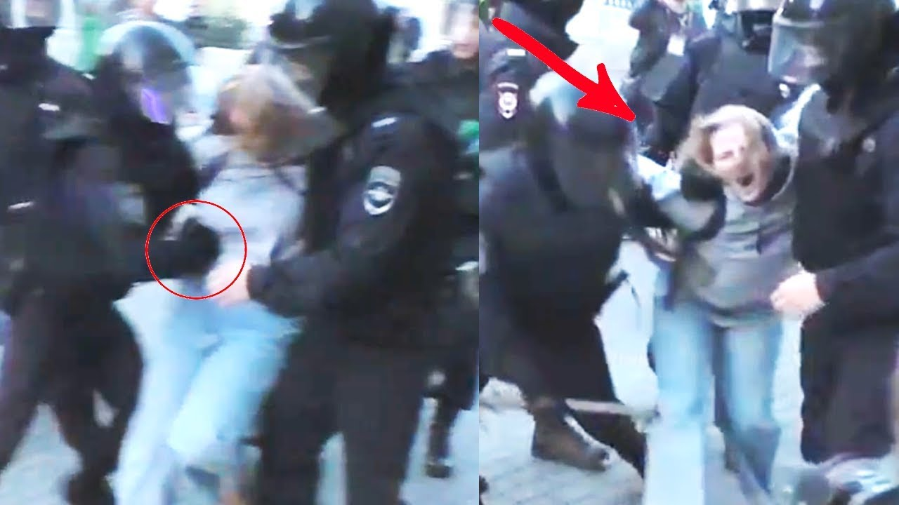 Russian police officer punches girl in the stomach. Moscow protests