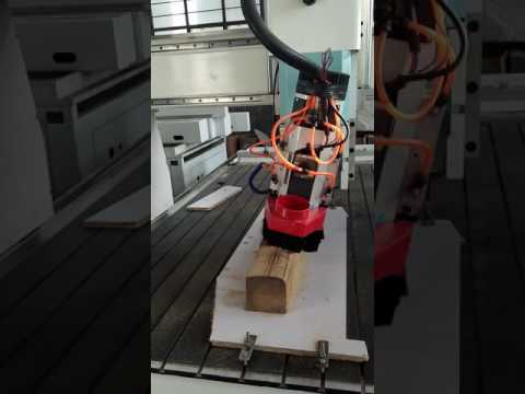 OMNI 4 Axis cnc router woeking on the wood