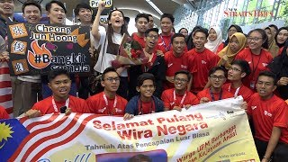 Jun Hoong, M'sian diving team get heroes' welcome at KLIA