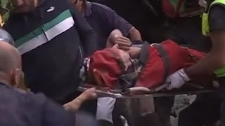 Raw: Rescuers Pull Survivor from Rubble in Italy