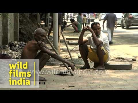 Workers engaged in cleaning sewer lines in Delhi
