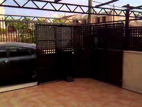 Puerta corredera hierro youtube for Puertas corredizas metalicas
