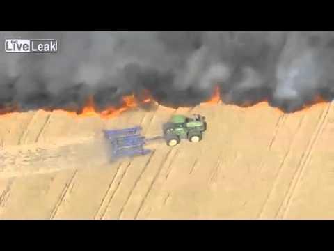 Фермер тушит пожар на поле видео