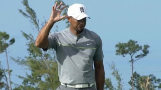 Tiger Woods walks in his 21-footer at Hero World Challenge