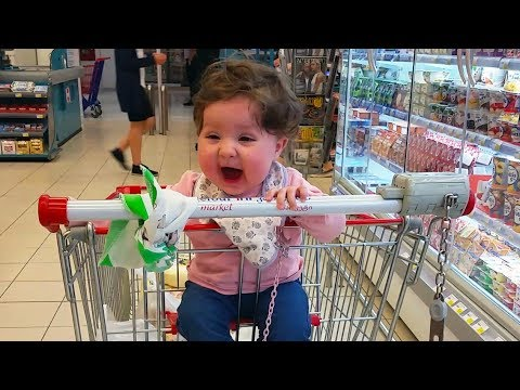 Cute Baby Sitting For The First Time In a Shopping Cart ...