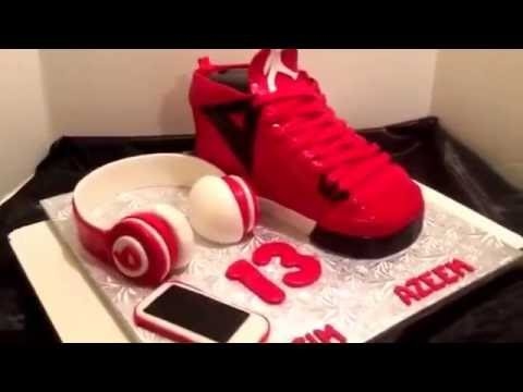 Jordan sneaker cake with beats and iPhone cakebossofchester on Fb