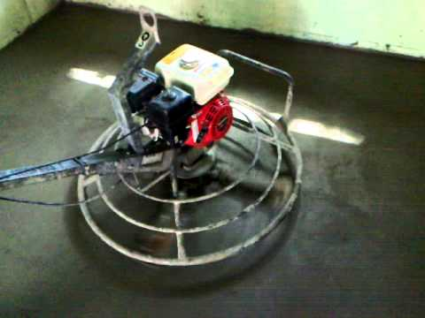 Finishing concrete basement floor slab with power trowel for smooth finish  Kanata - YouTube