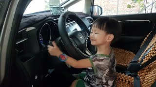 Baby learns to drive a car