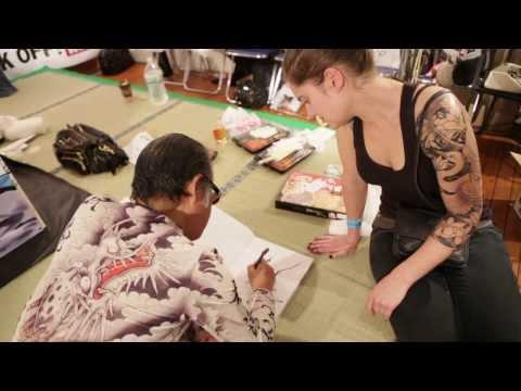 Horiyoshi III draw Japanese dragon at King of Tattoo convention in Tokyo