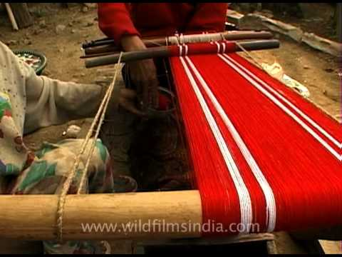 Lotha Naga ladies stretching yarns on their loin looms