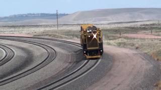 (HD) Hi Tech Anti- Coal Dust Fleet meets a BNSF Coal Train in Wyoming