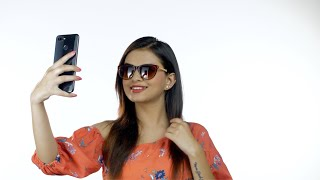 Beautiful young girl taking selfie in different poses against white background