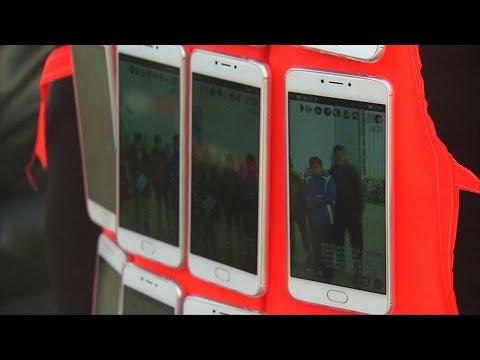 Artist uses 24 smartphones to live stream Beijing smog