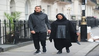 Janet Jackson heavily pregnant spotted shopping wearing a full Islamic