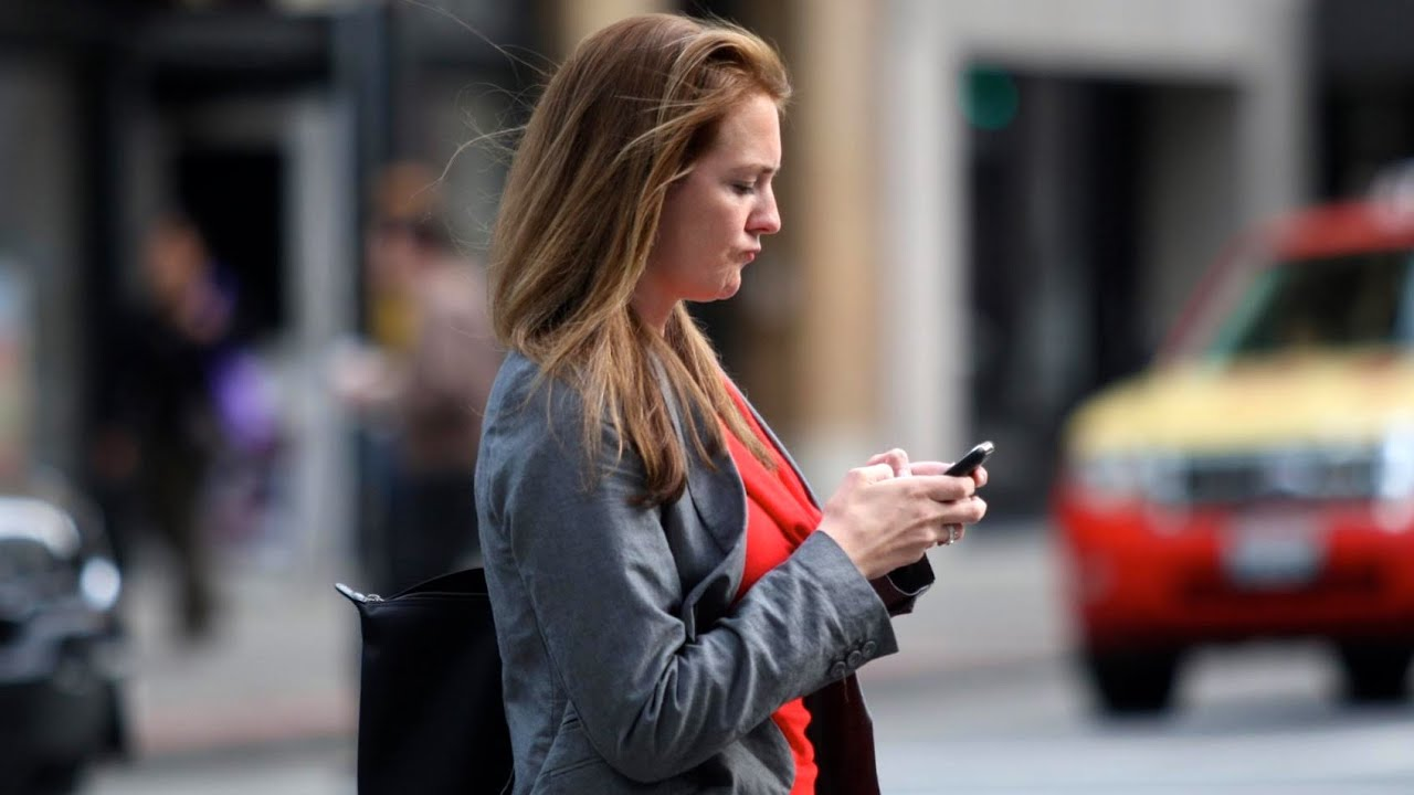 Image result for woman texting while walking