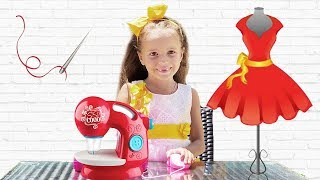 Arina Plays new dresses with Toy Sewing machine
