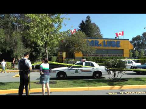 COQUITLAM SHOOTING 5 SHOTS FIRED MALE SHOT AT MR LUBE ON BARNET HWY SEP 28 2011 BY BCNEWSVIDEO