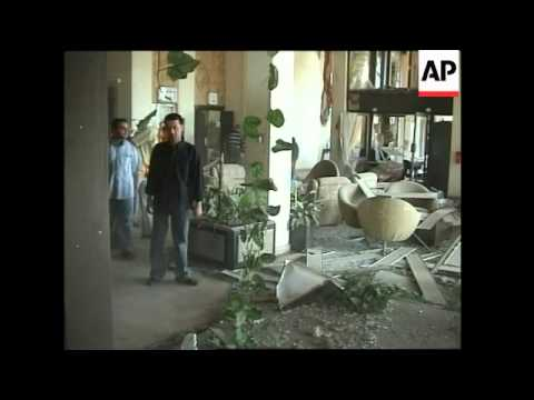 Aftermath of bomb blasts outside Baghdad hotels