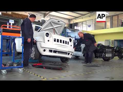 Brothers build Tunisian cars despite economic downturn