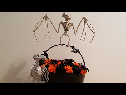 DIY paper marigold flowers made into a Halloween display