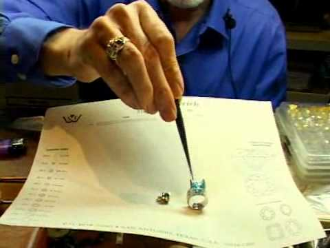 Diamond Jewelry Channel Settings - Diamond held in place by grooved rail in metal; Gold or Platinum