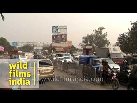 Heavy traffic moves along a busy road in Faridabad
