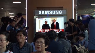 South Koreans applaud Trump-Kim handshake