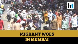 Migrants from Dharavi queue up to board buses, complain of misinformation