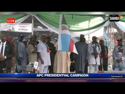 Another Faux Pas! Buhari Hands Over APC Flag To 'Our Governortorial Candidate'