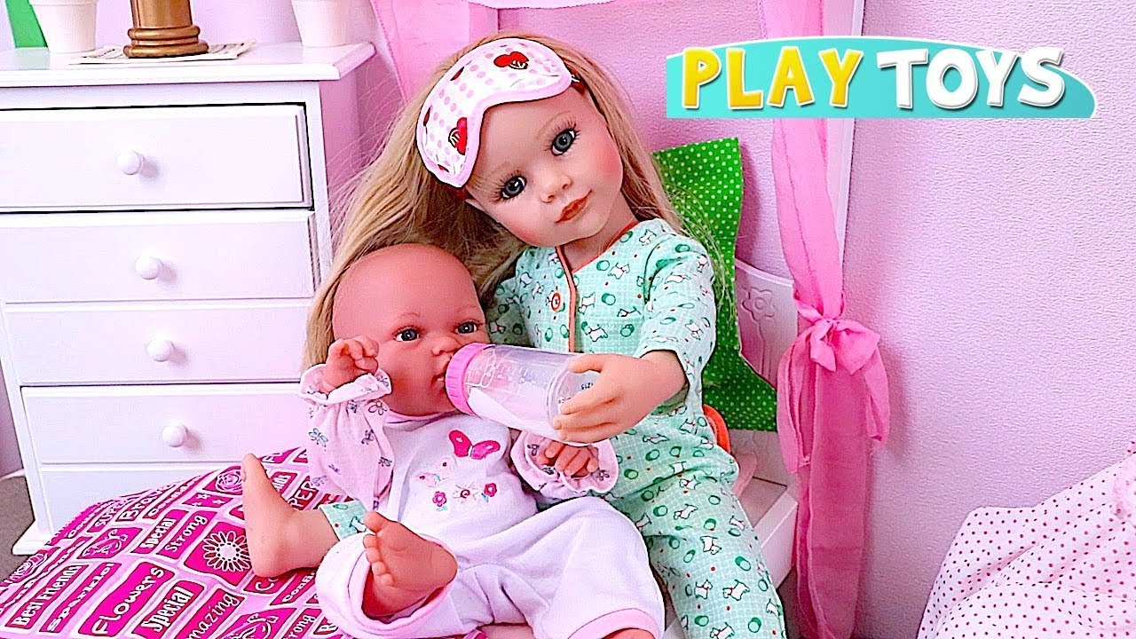 ad424a58c4772 Gotz Baby Doll Feeds and Dresses Baby Doll for Walk in the Park ...