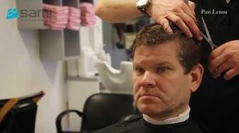 Miesten hiustenleikkaus hiustenleikkauskoneella ja saksilla.