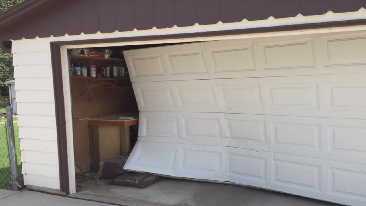 Garage door smashed in robbery youtube rubansaba
