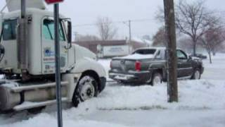 1/2 Ton Chevrolet Avalanche truck pulls stuck Semi & trailer out of snow